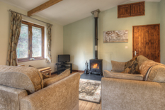 view of the open-plan lounge and dining area at Waldon Valley self catering lodge in devon